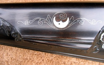 """Since that time, I have had other thoughts about it and decided to complete it. I made the following changes: I put together a set of 28"""", 54 cal. rifled barrels. The carving was not very sharp, looking more like a worn antique. This made me go with the theme to antique the whole rifle."""